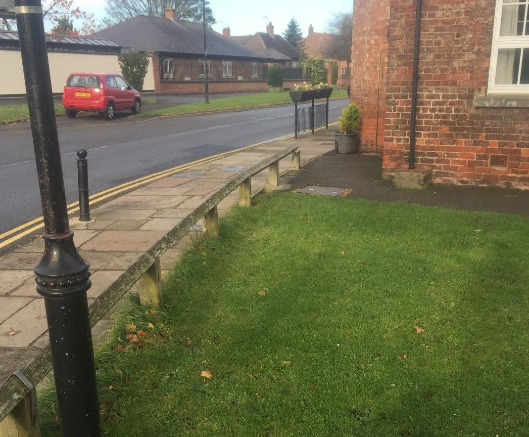 Work starts on replacement fence around village green.